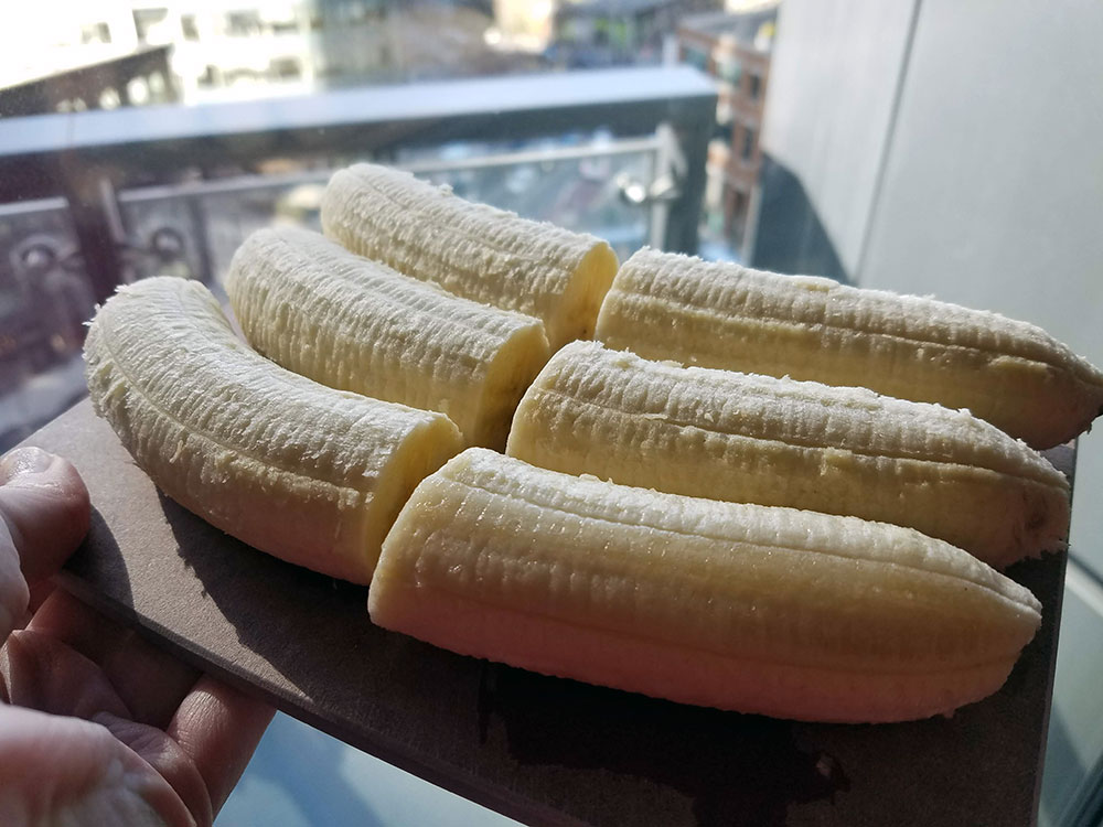 peeled bananas sliced in half